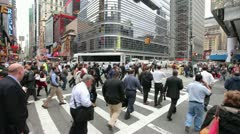Crowd walking crossing street at intersection in New York City slow motion 24p - stock footage