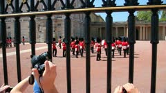 Crowd outside Buckingham Palace for guard change Stock Footage