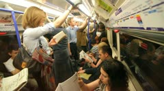 People riding the Tube in London Stock Footage