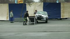 Stunt show, two wheels driving, man on the hood Stock Footage