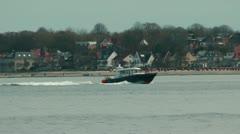 Coast Guard cruising near Laboe beach, Germany Stock Footage