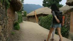 Women walking around folk Village in Nakan fortress Stock Footage