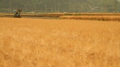 Timelapse of Farmer working on agricultural machine - stock footage