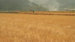 Farmer working on agricultural machine Stock Footage