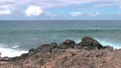 Easter Island swell rolls toward rocky outcrop 2a Stock Footage