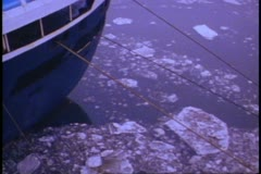 QE2 stern, snowing, ice floes in Hudson River, start of 1982 World Cruise Stock Footage