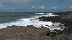 Easter Island waves on rugged outcrop 2d Stock Footage