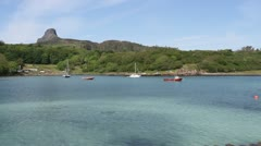 Boats and Isle of Eigg Scotland Stock Footage