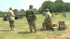 American soldiers relax before doing battle Stock Footage