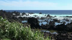 Easter Island lava and reflective blue pools 3c Stock Footage