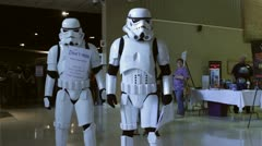 Stormtroopers talking to fans at museum Stock Footage