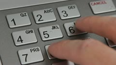 Close up of entering pin at ATM Stock Footage