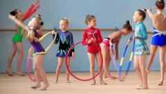 Girls gymnasts having training in gym before examination in Deriugina school Stock Footage