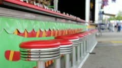 Empty seats at carnival game Stock Footage