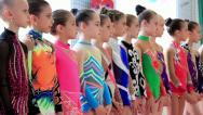 Young girls gymnasts in gym after final examination in Deriugina school Stock Footage