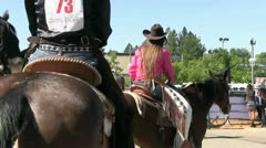 Cowgirls, horses, contestants wait on horse Stock Footage