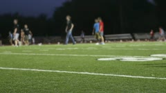People playing on Professional Football field Stock Footage