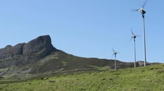 Wind turbines and An Sgurr Isle of Eigg Scotland Stock Footage
