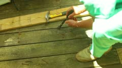 Nail prying nails nail board wood deck Stock Footage