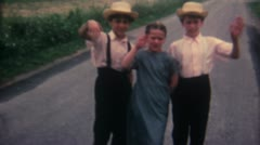 3 Kids wave Amish 16mm Super8 - stock footage