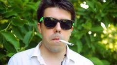 Risky business smoking smoke cool unhealthy 80s 1980s blunt marijuna - stock footage