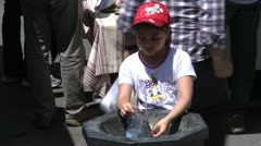 Girl filling bottle at water fountain. Stock Footage