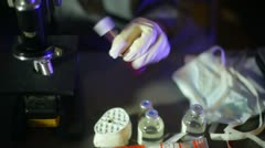 Blood sample shake from above birdseye view lab tech medical Stock Footage
