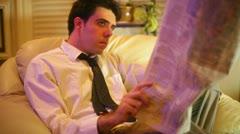 Business man newspaper read news reading Stock Footage