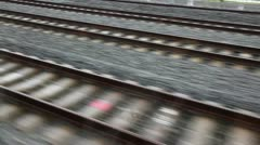 Close view of railroad track moving at high speed Stock Footage