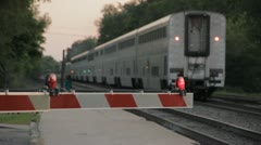 Stock Footage - Train Pulls away and gate goes up, police car passes Stock Footage