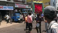 Indian people celebrate in a street procession Stock Footage