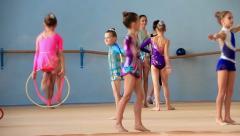 Girls gymnasts having training in gym before examination in Deriugina school Stock Footage
