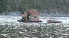 House boat on Yukon River woman P HD 1442 Stock Footage