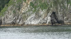 Island rock shore from boat Alaska P HD 1825 Stock Footage