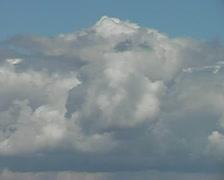 Time-lapse clouds roar over blue sky SD Stock Footage