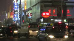 Heavy traffic car street Beijing night China congestion shop sign tourism light Stock Footage