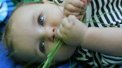 A child with a grass Stock Footage