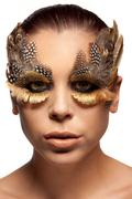 woman wearing creative feather make-up - stock photo