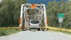 SUV on steel bridge Skagway P HD 8777 Stock Footage
