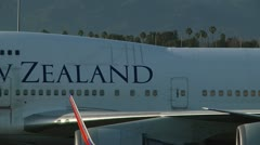 LAX NEWZEALAND Flight taxi on runway 0052IX Stock Footage