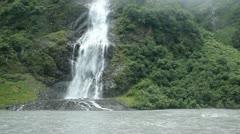 Waterfall fog glacial river Valdez Alaska P HD 8706 Stock Footage