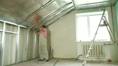 Installation of gypsum plasterboard ceilings Stock Footage