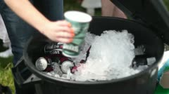 Filling cup with ice at outside party eagles cup ice chest Stock Footage