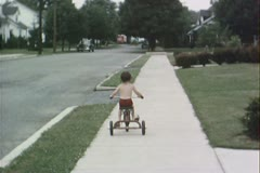 Riding away on tricycle - Vintage 8mm Stock Footage