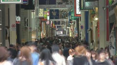 People visiting busy shopping gallery, Osaka, Japan Stock Footage