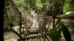 Stock footage suspension bridge in the jungle Stock Footage