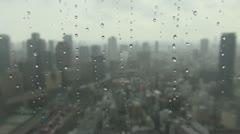 Aerial view of Osaka city during rain storm, Japan Stock Footage