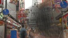 Timelapse People going toTsutenkaku Tower, Osaka, Japan Stock Footage