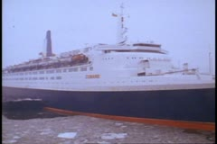 The QE2, Queen Elizabeth 2, pier NYC winter, start of 1982 world cruise, snowing Stock Footage