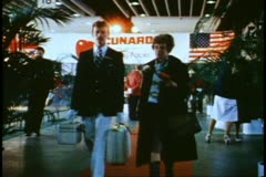1982 World Cruise of the QE2, Embarkation Hall, red carpet, palms, passenger Stock Footage